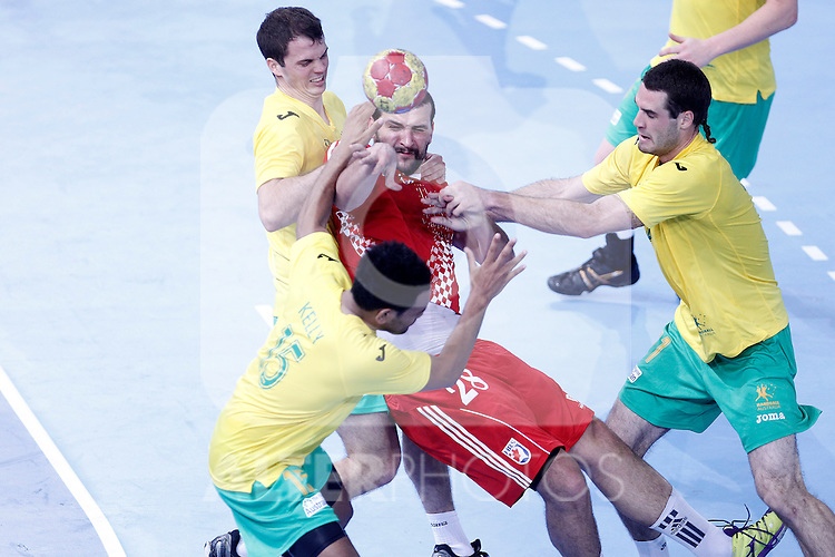 Croatia's Zeljko Musa (c) and Australia's Caleb Gahan (l), Daniel Kelly (b) and Ognjen Matic during 23rd Men's Handball World Championship preliminary round match.January 12 ,2013. (ALTERPHOTOS/Acero)