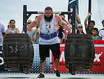 HAINAN ISLAND, CHINA - AUGUST 23:  Robert Oberst of USA competes at the Super Yoke event during the World's Strongest Man competition at Serenity Marina on August 23, 2013 in Hainan Island, China.  Photo by Victor Fraile