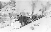 Freight train with flanger westbound leaving Cimarron with #360 pushing.<br /> D&amp;RGW  Cimarron, CO  Taken by Kindig, Richard H. - 2/22/1940
