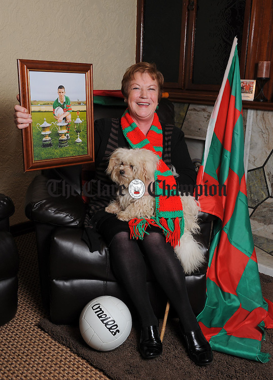 Celia Considine, dedidicated Kilmurry Ibrickane fan, and grandmother to Shane, (in photo frame)  Darren and Niall  Hickey and Mark Mc Carthy and her son in law is Vincent Talty on the Kilmurry Ibrickane panel. Photograph by John Kelly.