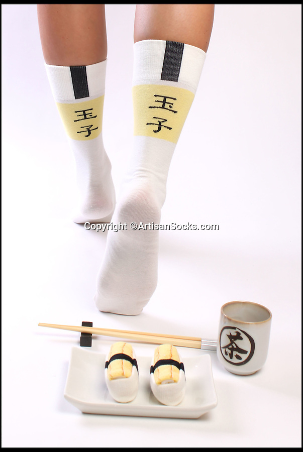 BNPS.co.uk (01202 558833)<br /> Pic: ArtisanSocks/BNPS<br /> <br /> ***Must Use Full Byline***<br /> <br /> Tamago Egg sushi socks. <br /> <br /> Soft Sushi Shuffle...<br /> <br /> Now, should you wish to, you can make your sock draw look like a sushi bar.<br /> <br /> These morsels of mouthwatering sushi might look tantalising but you wouldn't want to eat them - because they're actually rolled up socks.<br /> <br /> The super-realistic items of clothing are the latest bizarre trend sweeping the fashion world and have been an instant hit with shoppers.<br /> <br /> Unrolled they look like any other sock but rolled up they form seven different varieties of the raw fish snack, transforming your underwear drawer into a smorgasbord of sushi.<br /> <br /> The life-like 'flavours' include egg (tamago), salmon roe (ikura), shrimp (ebi), octopus (tako), tuna (maguro ), salmon (sa-mon) and trout (masuzishi).<br /> <br /> Sushi socks cost $6 a pair - around £3.70 - and can be bought from artisansocks.com.