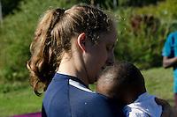 Natalya holding baby at Somali harvest festival,