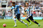 Jack Colback of Newcastle United chases Tottenham's Heung-Min Son during the Barclays Premier League match at St James' Park. Photo credit should read: Philip Oldham/Sportimage