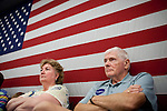 Iowans listen to GOP Presidential candidate Rep. Michele Bachmann speak at a town hall event in Marshalltown, Iowa, July 23, 2011.