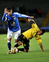 BOGOTA - COLOMBIA - 17 - 07 - 2016: Rafael Robayo (Izq.) jugador de Millonarios disputa el balón con Nelson Barahona (Der.) jugador de Alianza Petrolera, durante partido de la fecha 4 entre Millonarios y Alianza Petrolera, de la Liga Aguila II-2016, jugado en el estadio Nemesio Camacho El Campin de la ciudad de Bogota.  / Rafael Robayo (L) player of Millonarios vies for the ball with Nelson Barahona (R) player of Alianza Petrolera, during a match between Millonarios and Alianza Petrolera,  for the date 4 of the Liga Aguila II-2016 at the Nemesio Camacho El Campin Stadium in Bogota city, Photo: VizzorImage / Luis Ramirez / Staff.