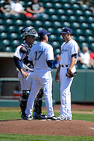 Columbus Clippers pitching coach Tony Arnold #17 talks with pitcher Joe Martinez #22 as catcher Roberto Perez #43 listens in during a game against the Toledo Mudhens on April 22, 2013 at Huntington Park in Columbus, Ohio.  Columbus defeated Toledo 3-0.  (Mike Janes/Four Seam Images)