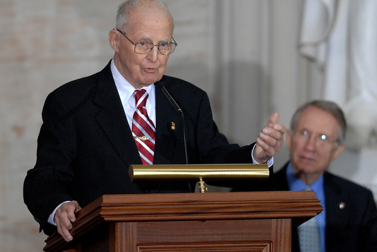 Congressional Gold Medal recipient Dr. Norman Borlaug speaks during a ceremony in the Rotunda honoring his achievements in agricultural science.  Senate Majority Leader Harry Reid, D-Nev., appears at right.