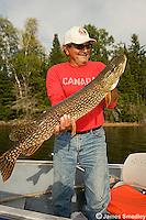Fisherman holding a huge northern pike