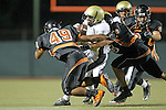 Beverly Hills, CA 09/23/11 - Okuoma Idah (Peninsula #24), Madison Moore (Beverly Hills #49) and \b58\ in action during the Peninsula-Beverly Hills Varsity football game.
