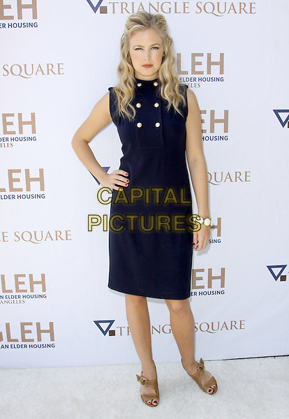 KERI LYNN.8th Annual GLEH Garden Partyheld At A Private Residence, Los Angeles, California, USA, .11th October 2009..full length navy blue military nautical dress gold brass buttons sleeveless hand on hip brown open toe sandals .CAP/ADM/KB.©Kevan Brooks/AdMedia/Capital Pictures.