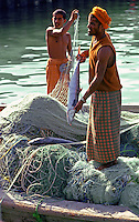 Fishermen pulling in their nets to gather up their  catch