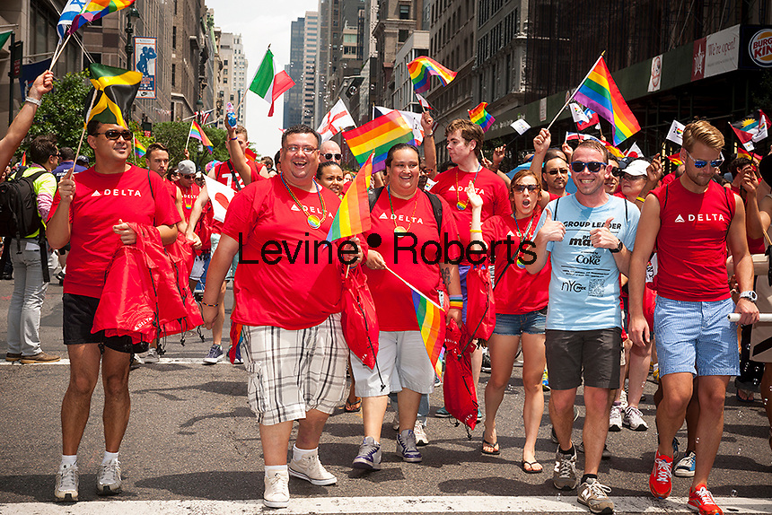 Delta Airlines workers in the 44th annual Lesbian, Gay, Bisexual and Transgender Pride Parade on Fifth Avenue in New York on Sunday, June 30, 2013. The turn out for the parade was especially large with the recent Supreme Court decision overturning the Defense of Marriage Act (DOMA) and California's Proposition 8.  (© Richard B. Levine)