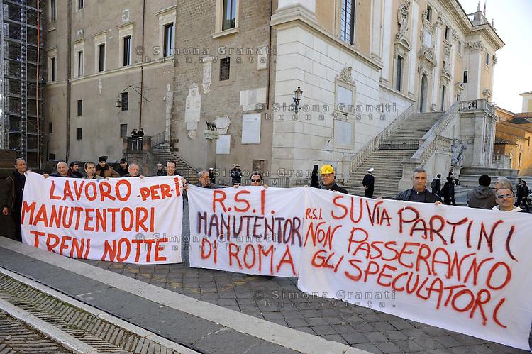 Roma, 23 febbraio 2012.Campidoglio.Gli operai della fabbrica occupata RSI (rail service italia) protestano contro la speculazione , per il lavoro e il trasporto pubblico