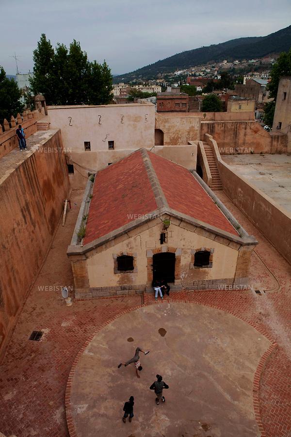 Algerie. Tlemcen. 17 mai 2011. Le palais El Mechoar. Citadelle jusqu'au debut de la colonisation de l'Algerie par la France, il est transforme en caserne par l'armee francaise. Apres l'Independance (1954 - 1962) , il devient ecole militaire jusqu'en 1986. L'ecrivain Yasmina Khadra y passa une partie de on enfance suivant l'enseignement de l'ecole des cadets.<br /> <br /> Algeria. Tlemcen. May 17th 2011. El Mechoar palace. A citadel until the beginning of the colonization of Algeria by France, it is transformed into barracks by the French. After independence (1954-1962), it became a military school until 1986. The writer Yasmina Khadra spent part of his childhood here.