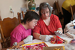 Concord CA, Intellectually handicapped young adults working on mask-making project at their residential home  MR