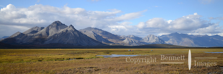 Campers preparing to float The Sheenjek River set up their tents in the shadow of Alaska's Brooks Range near Ambresvajun (Last) Lake in the Arctic National Wildlife Refuge in late August.
