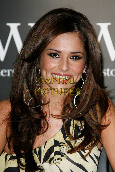 """CHERYL COLE .Girls Aloud at a signing of their new book """"Dreams that Glitter"""" at Waterstones, Piccadilly, London, England..October 9th 2008.headshot portrait tweedy.CAP/DAR.©Darwin/Capital Pictures."""