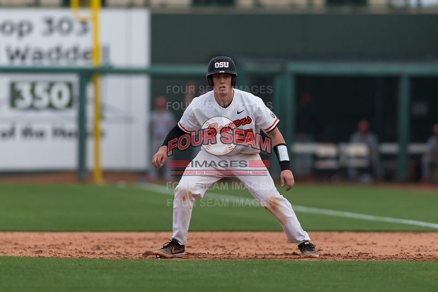 Oregon State Beavers catcher Adley Rutschman (35) takes his lead off first base during a game against the New Mexico Lobos on February 15, 2019 at Surprise Stadium in Surprise, Arizona. Oregon State defeated New Mexico 6-5. (Zachary Lucy/Four Seam Images via AP)