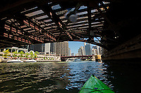 I pass under the Clark Street Bridge while kayaking the Chicago River.