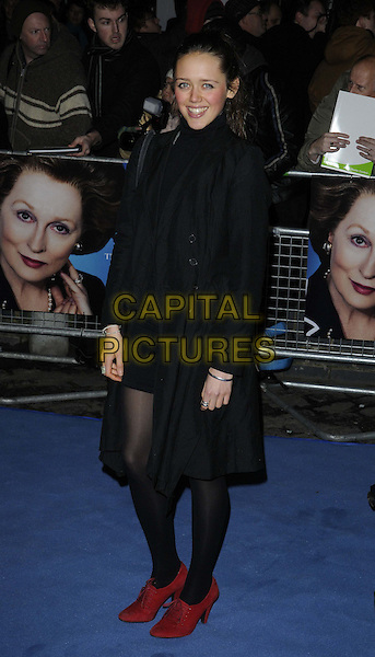 Daisy Head.'The Iron Lady' European Film Premiere at BFI cinema, Southbank, London, England..4th January 2012.full length black coat jacket dress tights red shoes .CAP/CAN.©Can Nguyen/Capital Pictures.