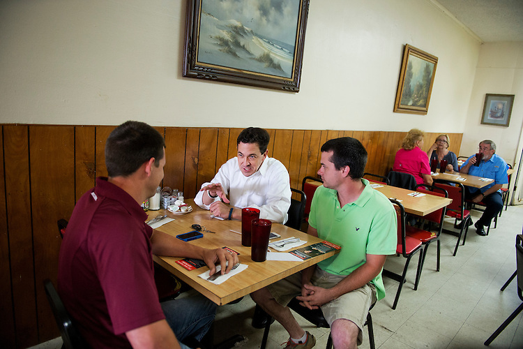 UNITED STATES - MAY 29: Chris McDaniel, Republican candidate for Mississippi Senate, speaks with brothers Stephen, left, and Jay Nicholson at Jean's Restaurant in Meridian, Miss., May 29, 2014. (Photo By Tom Williams/CQ Roll Call)