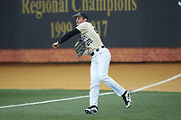 Wake Forest Demon Deacons right fielder Michael Ludowig (22) throws the ball back to the infield after making a catch in foul territory during the game against the Virginia Cavaliers at David F. Couch Ballpark on May 19, 2018 in  Winston-Salem, North Carolina. The Demon Deacons defeated the Cavaliers 18-12. (Brian Westerholt/Four Seam Images)