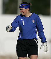 MAR 11, 2006: Quarteira, Portugal:  USWNT goalkeeper  (1) Jenni Branam directs a wall which way to go while playing Denmark in the Algarve Cup in Quarteira, Portugal.