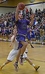 Spanish Springs Cougars Korbin Marcum drives past Reed Raiders Grant Cotter for a lay-up in their basketball game played on Friday night, February 10, 2017 at Reed High School in Sparks, Nevada.