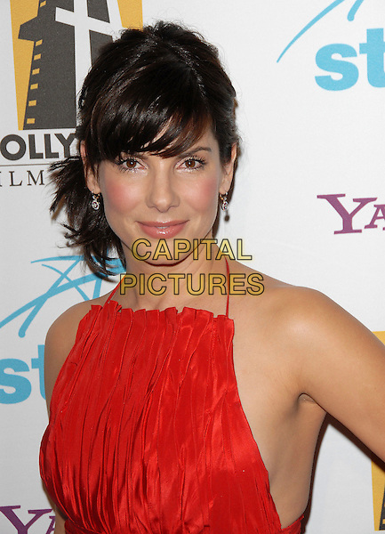 SANDRA BULLOCK.attends The Hollywood Film Festival 10th Annual Hollywood Awards Gala held at The Beverly Hilton in Beverly Hills, California, USA, October 23rd 2006..portrait headshot fringe red dress halterneck.Ref: DVS.www.capitalpictures.com.sales@capitalpictures.com.©Debbie VanStory/Capital Pictures