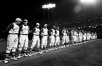HISTORICAL NIGHT: The Oakland Athletics line up along the third baseline before their first home game at the Oakland-Alameda County Coliseum in Oakland, April 17, 1968. 50,164 fans along with Hall of Famer Joe DiMaggio (far left) were in attendence as the A's lost to the Baltimore Orioles 4-1. <br />