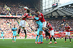 Daley Blind and Chris Smalling of Manchester United defend a header against West Ham's Andy Carroll during the Emirates FA Cup match at Old Trafford. Photo credit should read: Philip Oldham/Sportimage