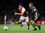 Arsenal's Alexis Sanchez goes Doncaster's Matty Blair during the Carabao Cup Third Round match at the Emirates Stadium, London. Picture date 20th September 2017. Picture credit should read: David Klein/Sportimage