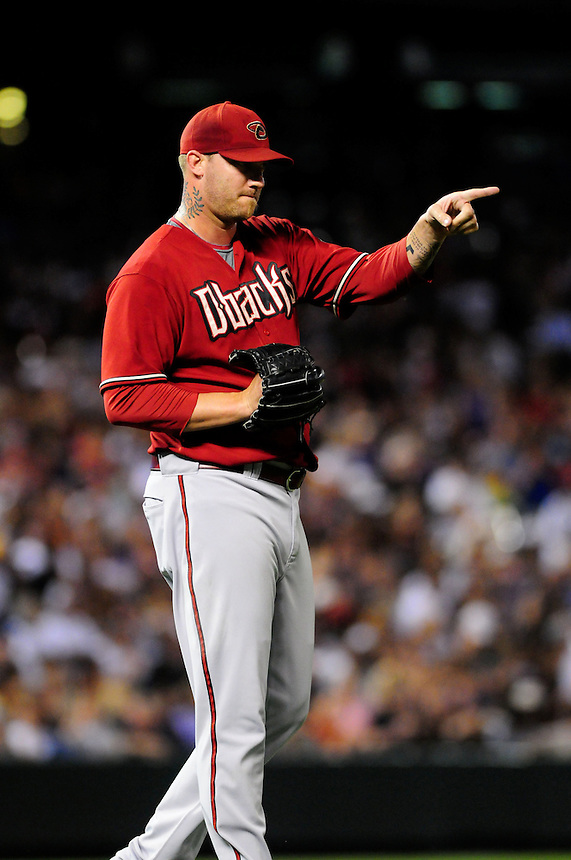 July 21, 2009: Diamondbacks relief pitcher Jon Rauch signals to the outfield after a nice play during a regular season game between the Arizona Diamondbacks and the Colorado Rockies at Coors Field in Denver, Colorado. The Diamondbacks beat the Rockies 6-5. *****For editorial use only*****