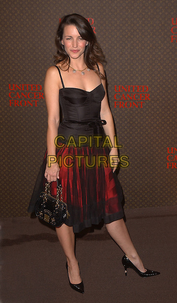 KRISTIN DAVIS.The 2nd Annual Louis Vuitton United Cancer Front Gala held at Universal Studios, Stage 24 in Universal City, California .November 8th, 2004.full length, red black chiffon sheer skirt, black singlet, ribbon belt, black purse, bag.www.capitalpictures.com.sales@capitalpictures.com.©Debbie Van Story/Capital Pictures