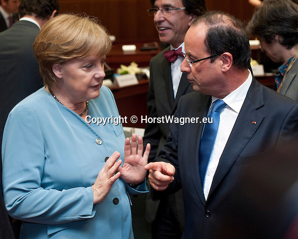 Brussels-Belgium - May 23, 2012 -- European Council, informal EU-summit meeting by Heads of State / Government; here, Angela MERKEL (le), Federal Chancellor of Germany, with Francois (François) HOLLANDE (ri), President of France -- Photo: © HorstWagner.eu