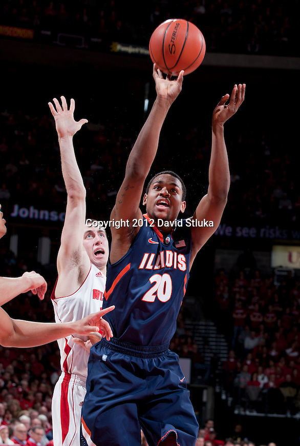 Illinois Fighting Illini guard Myke Henry (20) shoos the ball during a Big Ten Conference NCAA college basketball game against the Wisconsin Badgers on Sunday, March 4, 2012 in Madison, Wisconsin. The Badgers won 70-56. (Photo by David Stluka)