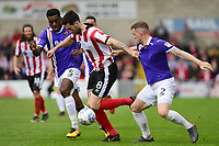 Lincoln City's Ollie Palmer vies for possession with Exeter City's Troy Archibald-Henville, left, and Exeter City's Pierce Sweeney<br /> <br /> Photographer Chris Vaughan/CameraSport<br /> <br /> The EFL Sky Bet League Two Play Off First Leg - Lincoln City v Exeter City - Saturday 12th May 2018 - Sincil Bank - Lincoln<br /> <br /> World Copyright &copy; 2018 CameraSport. All rights reserved. 43 Linden Ave. Countesthorpe. Leicester. England. LE8 5PG - Tel: +44 (0) 116 277 4147 - admin@camerasport.com - www.camerasport.com