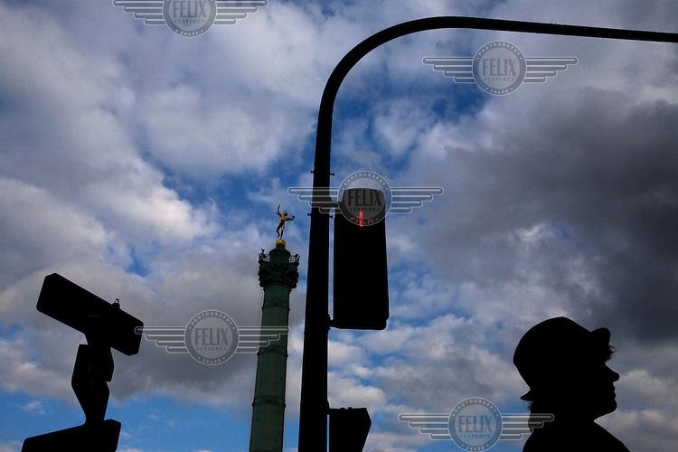 A lady walks through central Paris.