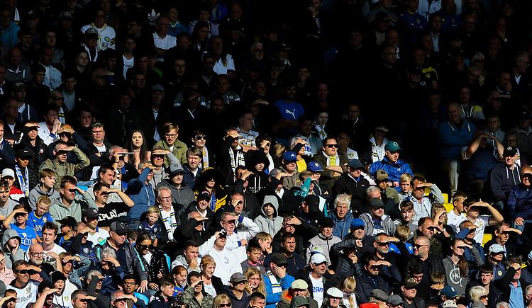 Leeds United fans shield their eyes from the sun during the second half<br /> <br /> Photographer Alex Dodd/CameraSport<br /> <br /> The EFL Sky Bet Championship - Leeds United v Swansea City - Saturday 31st August 2019 - Elland Road - Leeds<br /> <br /> World Copyright © 2019 CameraSport. All rights reserved. 43 Linden Ave. Countesthorpe. Leicester. England. LE8 5PG - Tel: +44 (0) 116 277 4147 - admin@camerasport.com - www.camerasport.com