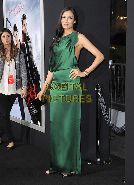Famke Janssen.attending the Paramount Los Angeles film premiere of 'Hansel and Gretel: Witch Hunters', held at The Grauman's Chinese Theater in Hollywood, California, USA, January 24th 2013..full length green silk satin dress hand on hip ruched draped black open toe shoes clutch bag                                       .CAP/DVS.©Debbie VanStory/Capital Pictures.