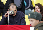 An England fan takes a picture of a Russian Policeman in the Luznikhi Stadium, Moscow<br /> <br /> Euro 2008 Qualifier<br /> Russia v England<br /> 17th October 2007<br /> --------------------<br /> Sportimage +44 7980659747<br /> admin@sportimage.co.uk<br /> http://www.sportimage.co.uk/