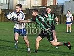Dundalk Young Irelands Ciaran Murray St Brigid's Thomas Mooney. Photo:Colin Bell/pressphotos.ie