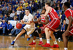 BROOKINGS, SD - FEBRUARY 23: Alex Arians #34 of the South Dakota State Jackrabbits drives to the basket against Ty Chisom #1 of the South Dakota Coyotes Sunday at Frost Arena in Brookings, SD. (Photo by Dave Eggen/Inertia)