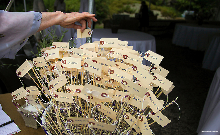 Guest Susan Shaw of Keene picks out her name tag table marker prior to adding ceremony in Harrisville, N.H., Saturday, July 6, 2013.  (Cheryl Senter for the New York Times)