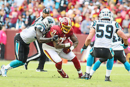Landover, MD - October 14, 2018: Washington Redskins offensive tackle Trent Williams (71) recovers a fumble during the  game between Carolina Panthers and Washington Redskins at FedEx Field in Landover, MD.   (Photo by Elliott Brown/Media Images International)