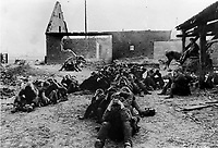 BNPS.co.uk (01202 558833)<br /> NARA/BNPS<br /> <br /> Captured German troops held in the Allied airborne drop zone on the east bank of the Rhine on the 24th of March. <br /> <br /> Remarkable rarely seen photos of heroic Allied soldiers fighting their way across Europe before crossing the River Rhine 75 years ago feature in a new book.<br /> <br /> They are published in Images of War, Montgomery's Rhine Crossing, which tells the story of the legendary offensive, nicknamed Operation Plunder, in March 1945.<br /> <br /> On the night of March 23, Field Marshal Bernard Montgomery's 21st Army Group launched a massive artillery, amphibious and airborne assault to breach the historic defensive water barrier protecting northern Germany.<br /> <br /> At the same time, the Americans, with the support of the British 6th Airborne Division, set in motion Operation Varsity - involving 16,000 paratroopers - on the east bank of the Rhine. They were dropped here to seize bridges to prevent German reinforcements from contesting the bridgeheads.<br /> <br /> Fierce fighting ensued, with much bloodshed on both sides as the Allies met determined resistance from machine gun nests. But the daring operation proved successful, helping to considerably shorten the war - the Nazis surrendered just six weeks later.