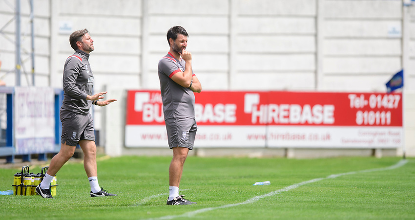 Lincoln City's assistant manager Nicky Cowley, left, and Lincoln City manager Danny Cowley shout instructions to their team from the technical area<br /> <br /> Photographer Chris Vaughan/CameraSport<br /> <br /> Football Pre-Season Friendly (Community Festival of Lincolnshire) - Lincoln City v Lincoln United - Saturday 6th July 2019 - The Martin & Co Arena - Gainsborough<br /> <br /> World Copyright © 2018 CameraSport. All rights reserved. 43 Linden Ave. Countesthorpe. Leicester. England. LE8 5PG - Tel: +44 (0) 116 277 4147 - admin@camerasport.com - www.camerasport.com