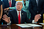U.S. President Donald Trump speaks before signing an executive order surrounded by small business leaders in the Oval Office of the White House in in Washington, D.C., U.S., on Monday, Jan. 30, 2017. Trump said he will dramatically reduce regulations overall with this executive action as it requires that for every new federal regulation implemented, two must be rescinded. <br /> Credit: Andrew Harrer / Pool via CNP