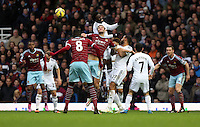 Sunday 07 December 2014<br /> Pictured: Wilfried Bony of Swansea (TOP) jumps over Andy Carroll of West Ham<br /> Re: Premier League West Ham United v Swansea City FC at Boleyn Ground, London, UK.