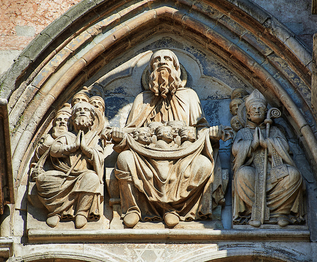 Sculpture from The Last Judgement with Gods and the saved sould in his lap on the facade of the 12th century Romanesque Ferrara Duomo, Italy